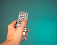 Hand holding a remote control Royalty Free Stock Image
