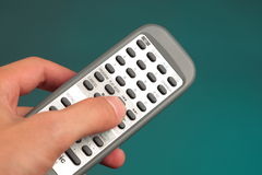 Hand holding a remote control Royalty Free Stock Photos