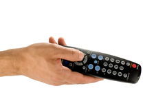 Hand holding remote control Royalty Free Stock Photos