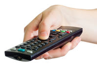 Hand holding a remote control. A male hand holding a remote control, isolated on white Stock Photos