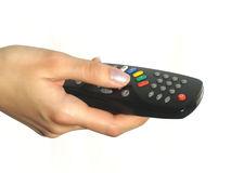 Hand holding remote control stock photos