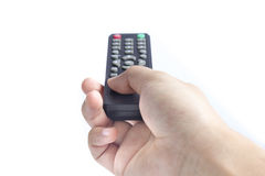 A hand holding a remote control Royalty Free Stock Photo