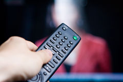 Hand holding a remote control Royalty Free Stock Photo