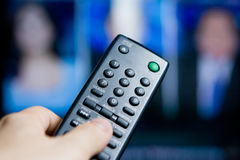 Hand holding a remote control Stock Photography