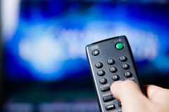 Hand holding a remote control Royalty Free Stock Photography