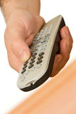 Hand holding a remote control Royalty Free Stock Images