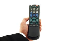 Hand Holding Remote Control Isolated on White Royalty Free Stock Image