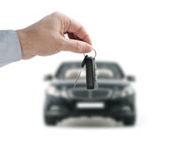 Hand holding a remote control key Stock Images