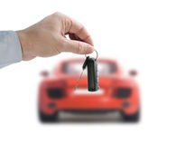 Hand holding a remote control key Royalty Free Stock Image