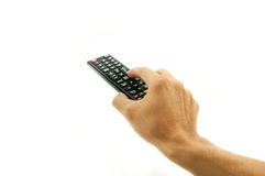 Hand holding remote TV Royalty Free Stock Image
