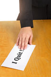 Hand holding resignation letter on the desk of the boss. Hand holding resignation letter on the desk of the boss royalty free stock image