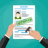 Hand holding resume with Approved stamp mark Stock Image
