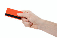 Hand holding retail or credit card with magstripe. Isolated on white stock photography