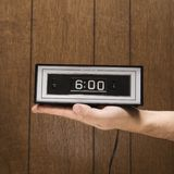 Hand holding retro clock set Royalty Free Stock Photography