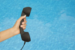Hand holding retro landline telephone receiver Royalty Free Stock Image