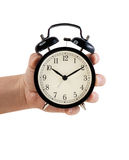 Hand holding Retro style alarm clock, isolated on white Stock Photos