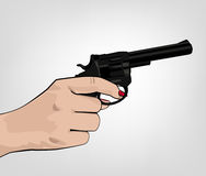 Hand holding revolver Royalty Free Stock Image