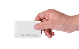 Hand holding RFID card. Hand holding white RFID card, close up Royalty Free Stock Photo