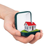 Hand holding ring box with house inside Royalty Free Stock Photo