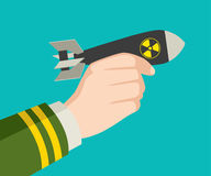 Hand holding a rocket nuclear bomb Stock Image