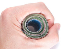 Hand holding a roll of banknotes Stock Photo