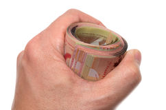 Hand holding a roll of banknotes. Hand holding a roll of 50 dollars Canadian Stock Image