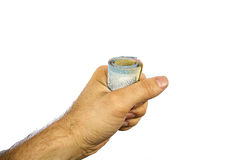 Hand holding a roll of notes Royalty Free Stock Photo
