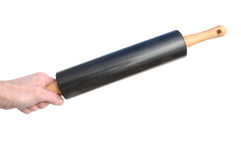 Hand Holding a Rolling Pin Royalty Free Stock Image