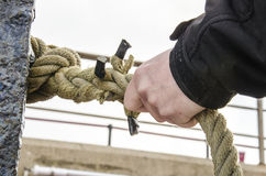 Safety - Hand holding a rope Stock Images