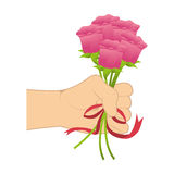 Hand holding a roses bouquet with ribbon tape Royalty Free Stock Photo