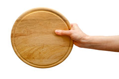 Hand holding round plate Royalty Free Stock Photography