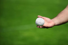 Hand holding a rounders ball Stock Image