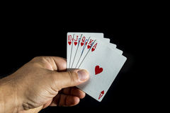 Hand holding a royal flush Royalty Free Stock Photography