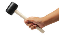 Hand holding a rubber hammer with clipping path. Stock Photo