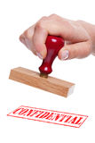 Hand holding a rubber stamp with the wordConfident Stock Images