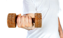 Hand holding rusty dumbbell Royalty Free Stock Photography