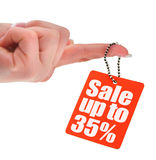 Hand holding sale tag Stock Photo