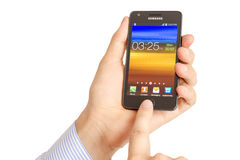 Hand holding the Samsung Galaxy S2 Royalty Free Stock Images