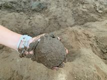 Hand holding sand Development of learning activities for swimming, playing sand, children, boy stock images