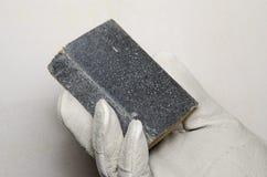 Hand holding a sanding sponge Stock Photo