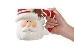 Hand holding Santa mug Royalty Free Stock Photography