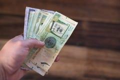 Hand holding saudi riyal bank notes Royalty Free Stock Photo