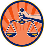 Hand holding scales of justice Royalty Free Stock Photo