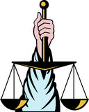 Hand holding scales of justice Royalty Free Stock Image