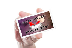 Hand holding scary Halloween party card or invitation Stock Photos