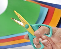 Hand holding scissors Stock Images