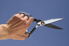 A hand holding a  scissors Stock Image