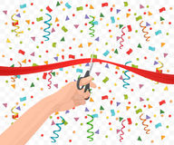 Hand holding scissors and cutting red ribbon on the transperant background with confetti. Royalty Free Stock Image