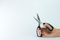 Hand holding scissors Stock Photography
