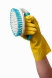 Hand holding scrub brush Royalty Free Stock Photos